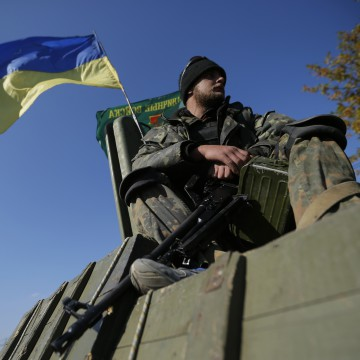 A Ukrainian serviceman sits on an armoured vehicle at a military camp near the eastern Ukrainian town of Debaltseve October 6, 2014. REUTERS/David Mdzinarishvili (UKRAINE - Tags: POLITICS CIVIL UNREST MILITARY)